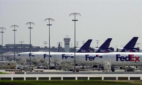 FedEx planes sit on the tarmac in Memphis, Tenn., Wednesday, Sept. 12, 2001, grounded at the company's main hub at Memphis International Airport until the FAA lifts the ban on flying following Tuesday's terrorist attack in New York and Washington. (AP Photo/The Commercial Appeal, Alan Spearman) Published in NYTimes 09/13/01 Published Caption: FedEx, which is based in Memphis, said many of its deliveries could be at least two days late because its fleet of 660 aircraft in North America is grounded by the nationwide ban on air travel. (Rollin Riggs for the New York Times) FOR BOSTONGLOBE.COM GALLERY ONLY!!!!!! airlinegallery